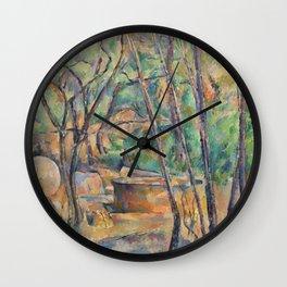 Paul Cézanne -Millstone and Cistern under Trees Wall Clock
