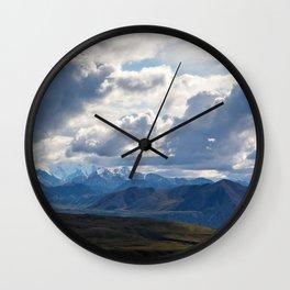 Denali peaking through the clouds Wall Clock