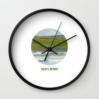 ruben ireland Wall Clocks featuring Ireland by Dustin Hall
