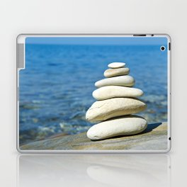 Pyramid of stones in sea shore Laptop & iPad Skin