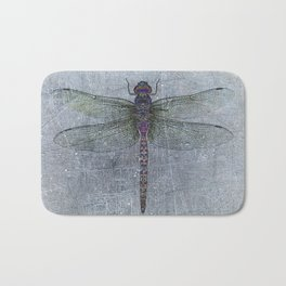 Dragonfly on blue stone and metal background Bath Mat