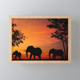 Elephants in the African sunset Framed Mini Art Print
