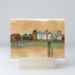 tea pots on the shelf Mini Art Print