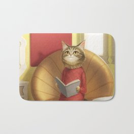 A cat reading a book Bath Mat