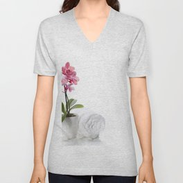 spa composition with beautiful pink orchid over white Unisex V-Neck