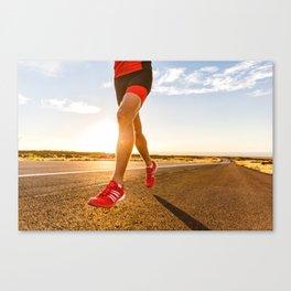 Triathlon running athlete training on road in running shoes Canvas Print