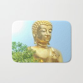 sitting budda in blue sky Bath Mat