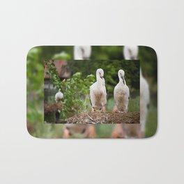 Orphaned two White Storks Bath Mat