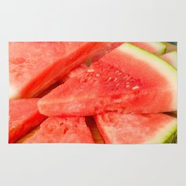 Slices of watermelon on a wood cutting board Rug