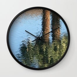 Palm Trees Reflecting in Cool Lake Waters Wall Clock