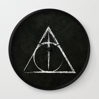 harry potter Wall Clocks featuring Deathly Hallows (Harry Potter) by Daizy Jain
