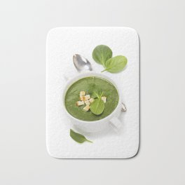 Traditional Spinach cream soup with croutons and fresh spinach leaf on top Bath Mat