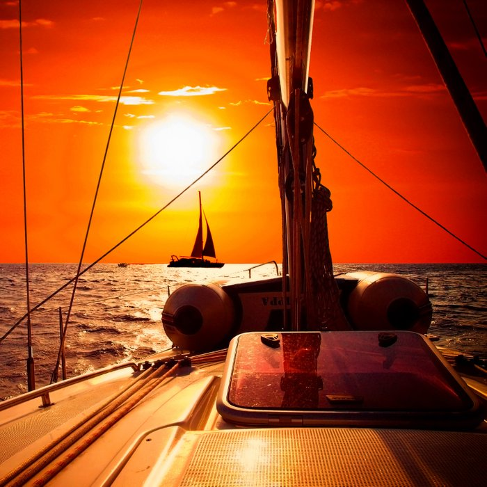 Yacht at Sunset Comforters