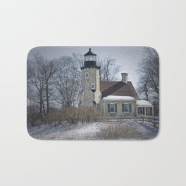 Lighthouse during Winter in Whitehall Michigan Bath Mat