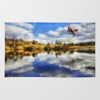 aviation Area & Throw Rugs featuring Over The Lake by Ian Mitchell