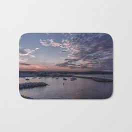 Sunset over Rockport Harbor Bath Mat