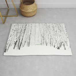 Green bench in white winter forest Rug