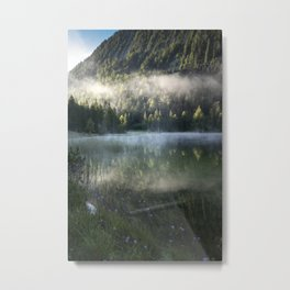 Fog cloud over lake, Flowers in Front. Amazing shot of the Ferchensee lake in Bavaria, Germany. Scenic foggy morning scenery at sunrise with mountain in the back. Metal Print