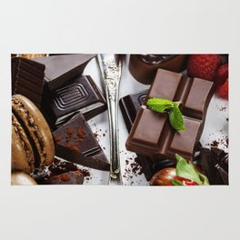 An assortment of  chocolate with nuts, muffins, macaroons Rug
