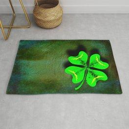 Four Leaf Clover on Green Textured Background Rug