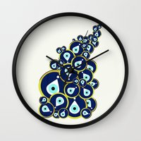 evil eye Wall Clocks featuring Evil eye by Kanika Mathur Design