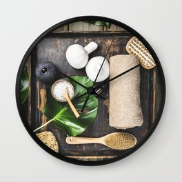flat lay layout with monstera leaves and cosmetic care products Wall Clock