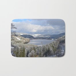 first snow on autumn leaves Bath Mat