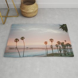 palm trees sunset vi / san clemente, california Rug