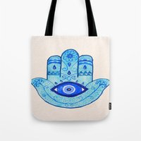 islam Tote Bags featuring Hamsa - Blue by Hayley Lang