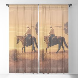 A long hot ride in the saddle. A cowboy makes his way through the desert in the sweltering hot sun. Crows circle the horse in a surreal photography. Sheer Curtain