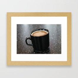 Coffee in a black mug Framed Art Print