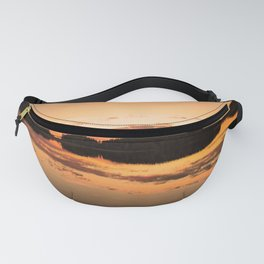 Beautiful sunset - glowing orange - forest silhouette and reflection Fanny Pack