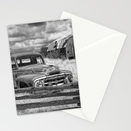 Black and White of Rusted International Harvester Pickup Truck behind wooden fence with Red Barn in Stationery Cards