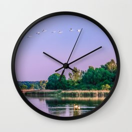 Swans are flying Wall Clock