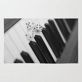 Piano keys with dice Rug