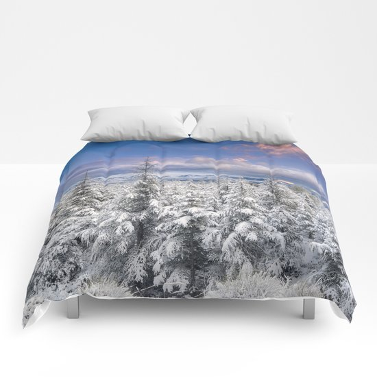 """Mountain light"". Snowy forest at sunset Comforters"