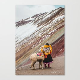 Peruvian girl in Quechua dress with her pet llama in front of a snow-capped Rainbow Mountain Canvas Print