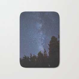 Starry night with the Milky Way in a pine forest Bath Mat