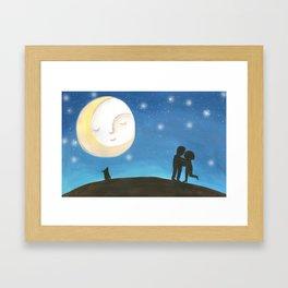 A kiss under the moon Framed Art Print