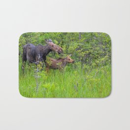 Moose and calf by Teresa Thompson Bath Mat