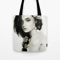 katniss Tote Bags featuring Katniss by Isaiah K. Stephens