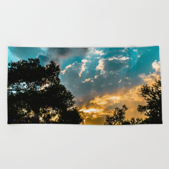 The glow Beach Towel