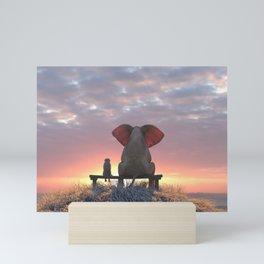 elephant and dog watch the sunrise on the seashore Mini Art Print