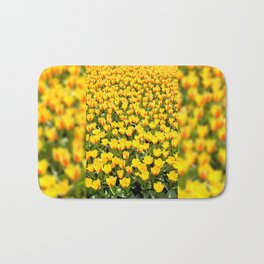 Yellow and red Stresa tulips abloom Bath Mat