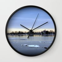 finland Wall Clocks featuring helsinki (finland) - island by aune