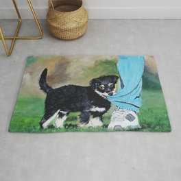 Playful dog..a fluffy cute puppy..pulling owner's denim and playing and goofing around. Rug