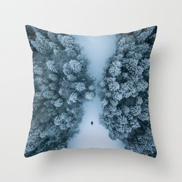 Man lying in the snow on a frozen lake in a winter forest - Landscape Photography Throw Pillow