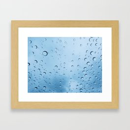 Drops of water on a glass, on a blue background Framed Art Print
