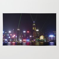 hong kong Area & Throw Rugs featuring Hong Kong Laser Show by Lynn Bolt