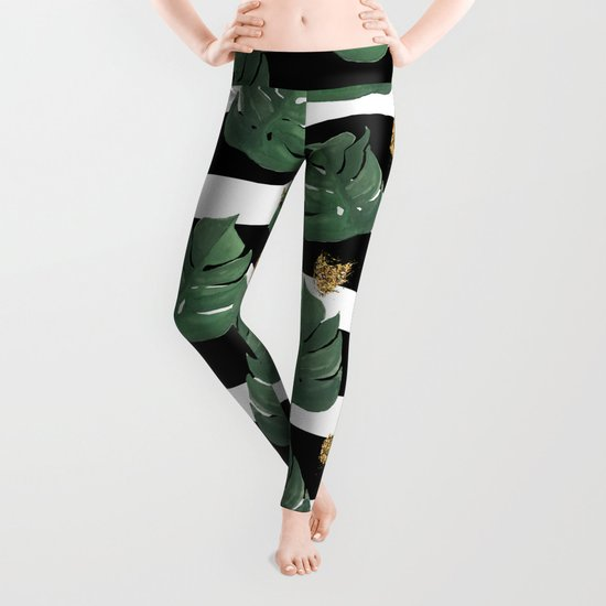 Seamless tropical leaves pattern on stripes background. Greens leaves of exotic monstera plant. Retr Leggings